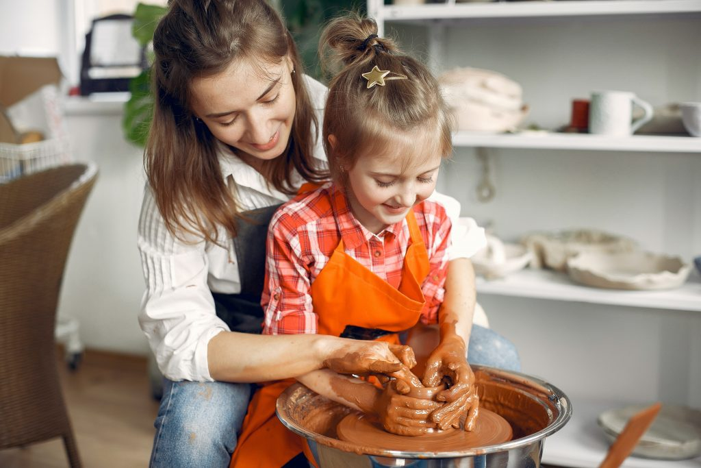 woman child pottery